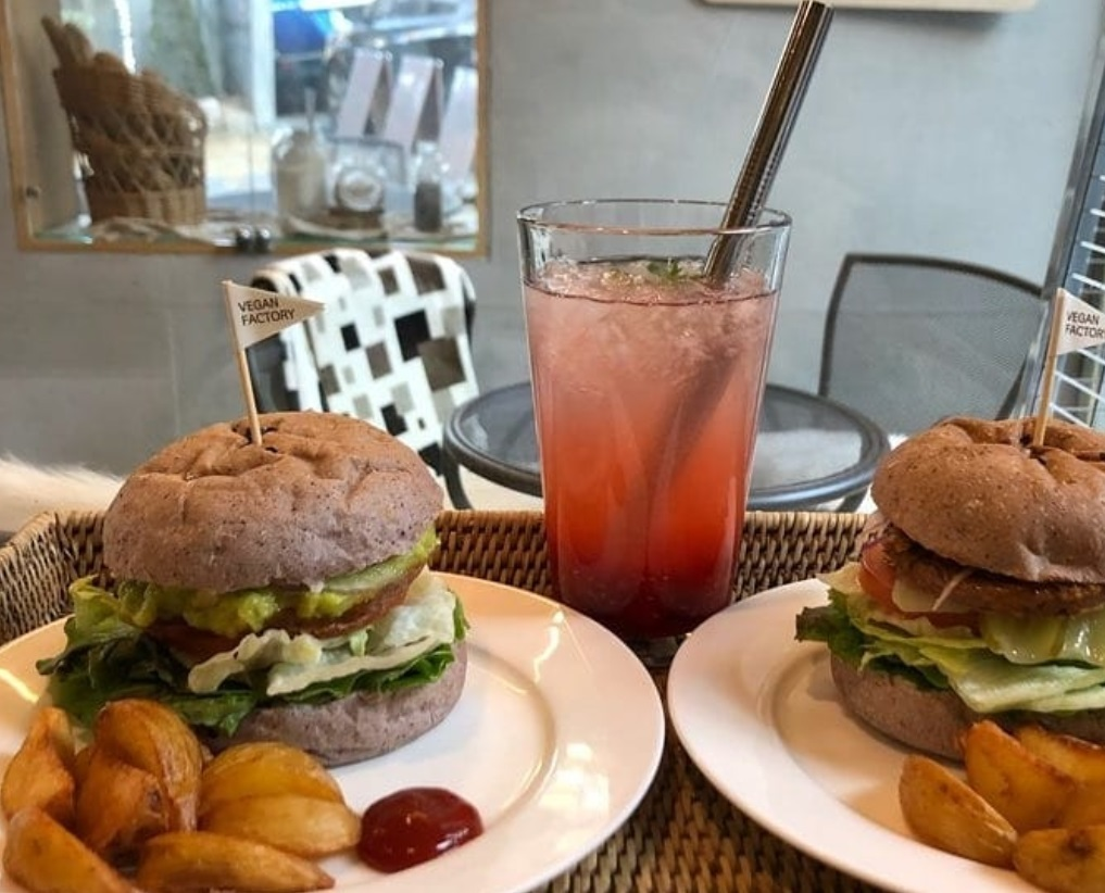 Yummyyomi's avocado burger and vegetarian cheese burger, with fruit tea-ade and French fries