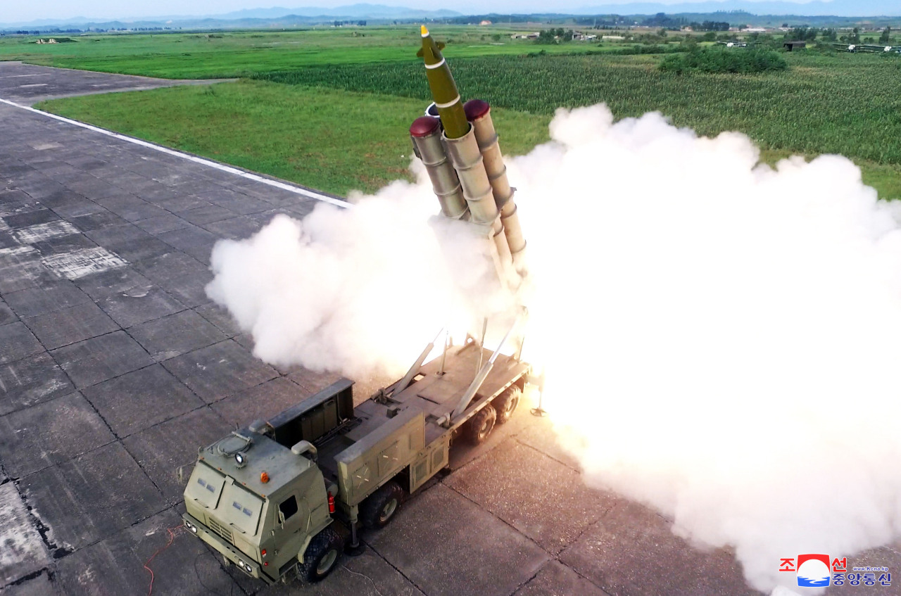 A missile is fired during the test of a multiple rocket launcher in this undated photo released on Sunday. (Yonhap)