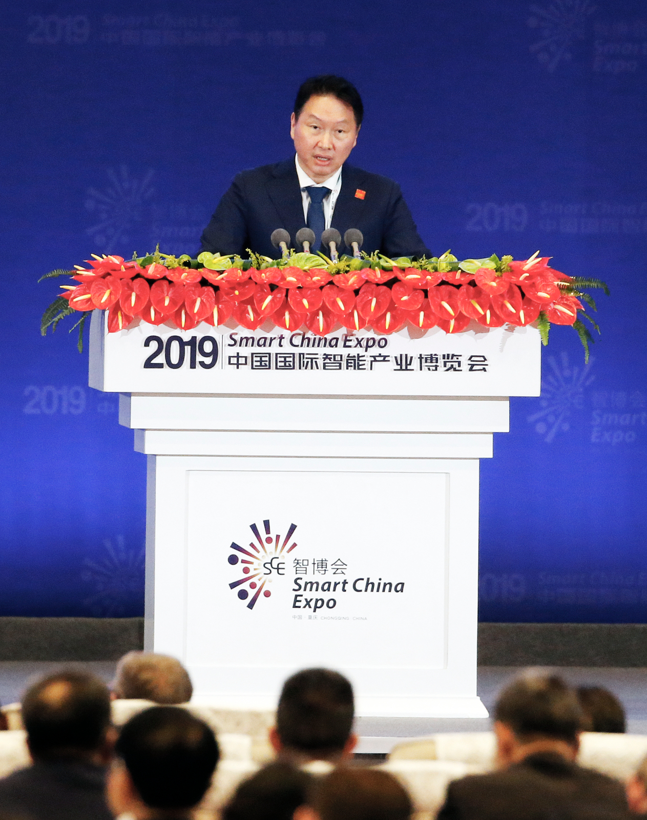 SK Group Chairman Chey Tae-won speaks at the opening ceremony of the Smart China Expo in Chongqing on Monday. (SK Group)