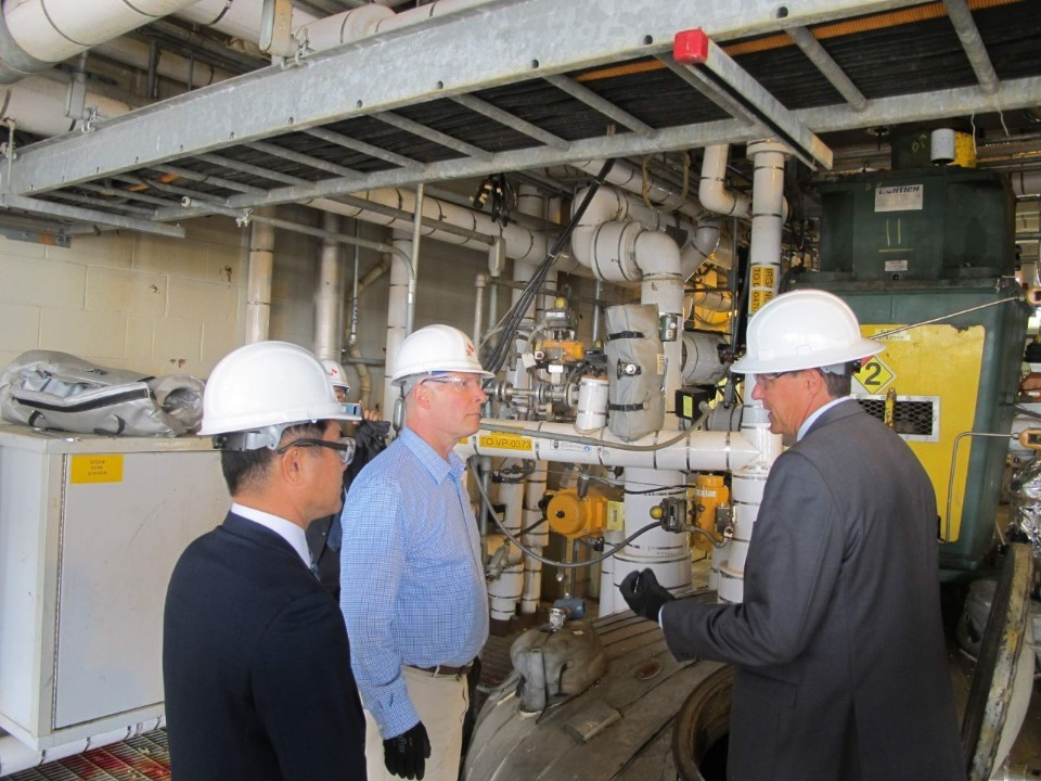 Steve Persyn (right), site leader for SK Saran Americas, Rep. John Moolenaar (center) and Jay Kim, president of SK Global Chemical Americas, visit the main facility of SK Saran Americas in Midland, Michigan, on Monday. (SK Innovation)