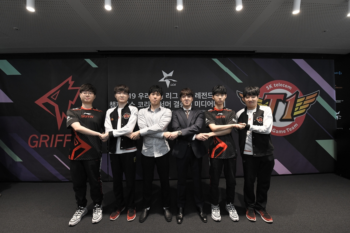 Griffin and SKT T1 hold hands at the media day event Tuesday at LoL Park in Jongno, central Seoul. (Riot Games)