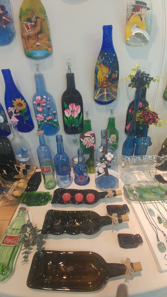 Tenant craftsman Nam Keum-ho's works, upcycled from used glass bottles, are on display at his studio. (Lee Sun-young/The Korea Herald)