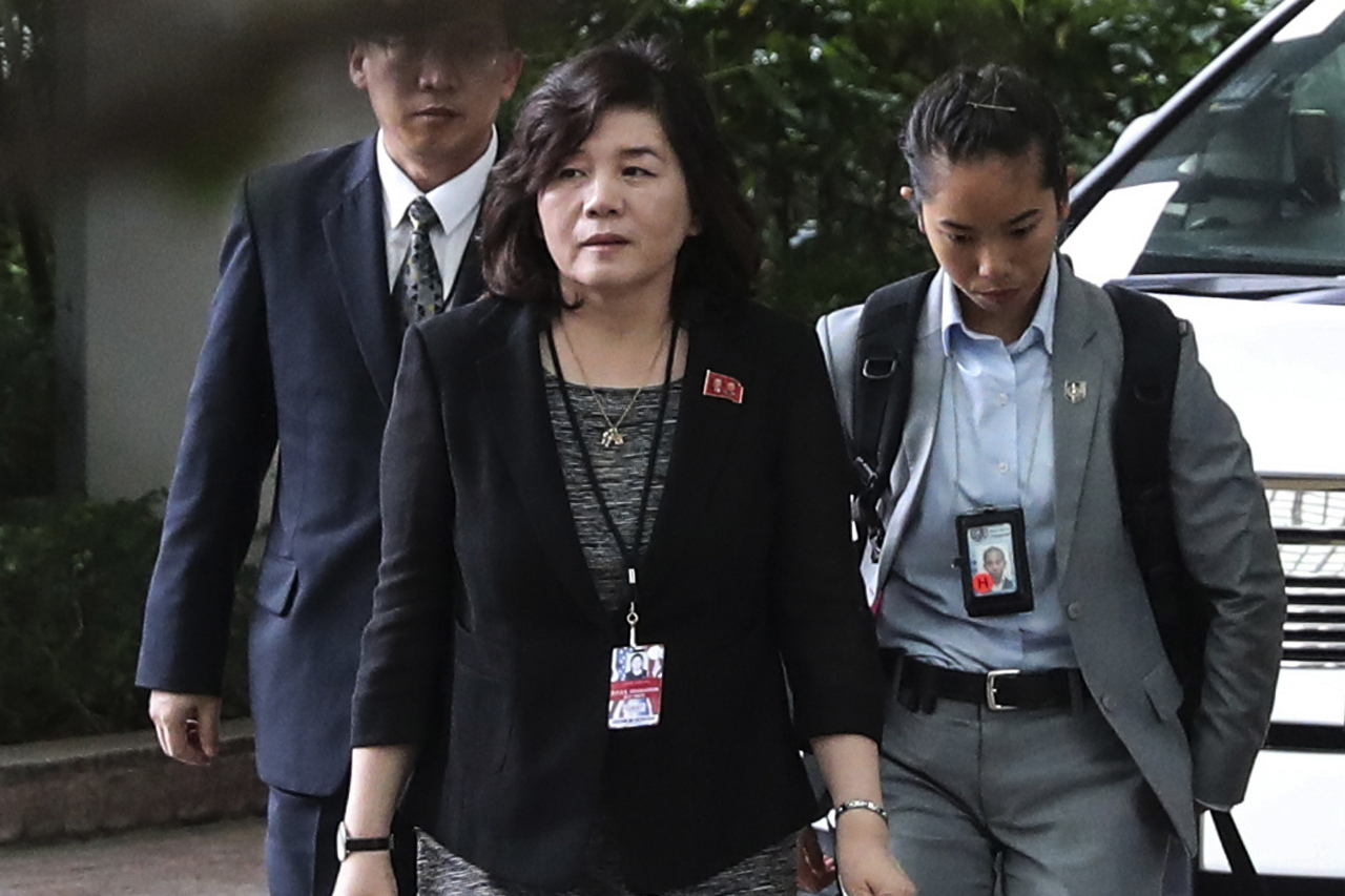 In this June 11, 2018, file photo, North Korean Vice Foreign Minister Choe Son-hui, center, arrives for a meeting with US Ambassador to the Philippines Sung Kim at the Ritz-Carlton Millenia Hotel in Singapore ahead of the summit between US President Donald Trump and North Korean leader Kim Jong-un. (AP-Yonhap)