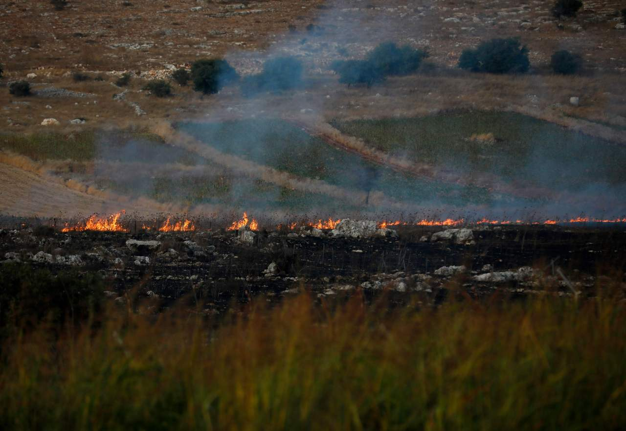 This picture taken on September 1, 2019 from a location near the northern Israeli town of Avivim, close to the border with Lebanon, shows fires and smoke rising after Lebanon`s Shiite Muslim Hezbollah movement fired anti-tank missiles into northern Israel. (AFP)