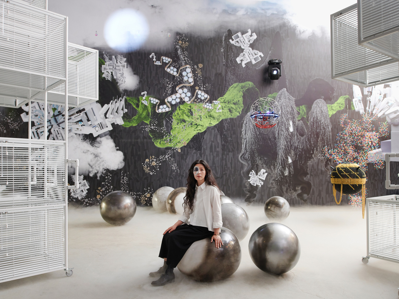 Yang Hae-gue poses for pictures on a gym ball shown at her solo exhibition at Kukje Gallery. (Kukje Gallery)