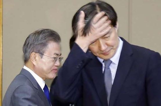 President Moon Jae-in (left) and Cho Kuk, formerly senior presidential secretary for civil affairs and current justice minister nominee (Yonhap)