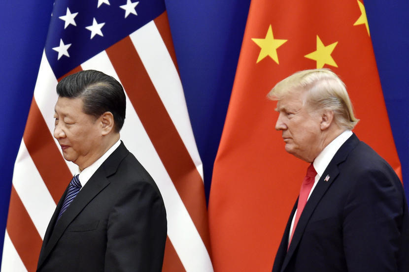US President Donald Trump and Chinese President Xi Jinping are seen at the Great Hall of the People in Beijing in November 2017. (AP-Yonhap)