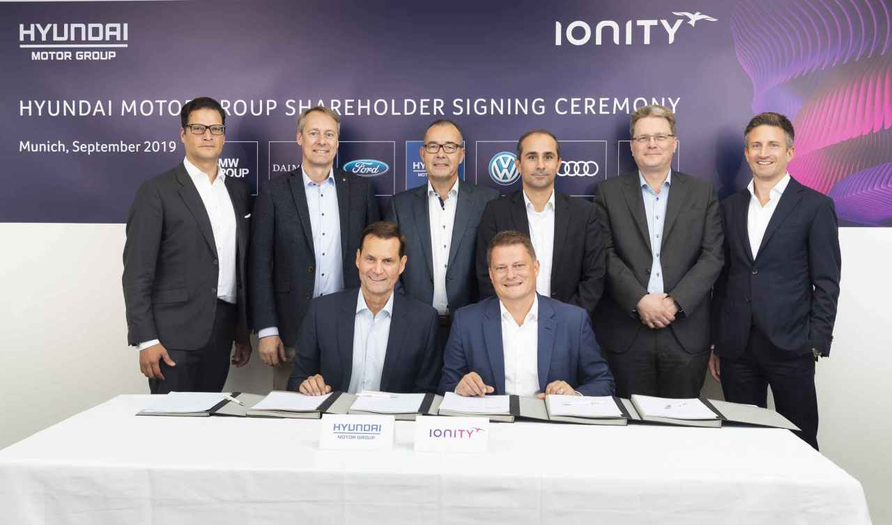 Thomas Schemera (front left), executive vice president and head of product planning and strategy at Hyundai Motor and Kia Motors, poses for a photo with Ionity officials at the joint venture's headquarters in Munich on Friday. (Hyundai Motor Group)