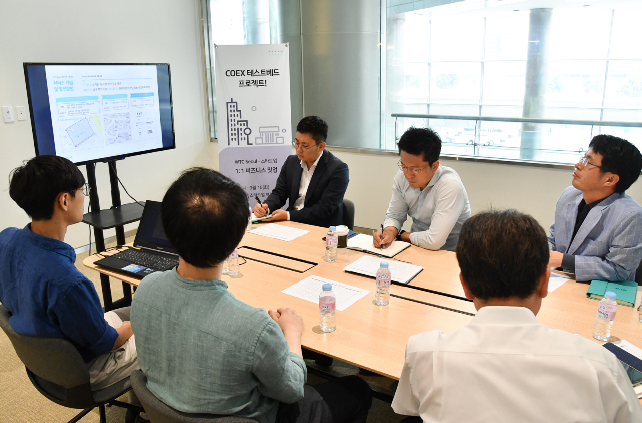 Representatives of startups and experts attend business meetings at Coex in Seoul on Tuesday. (KITA)