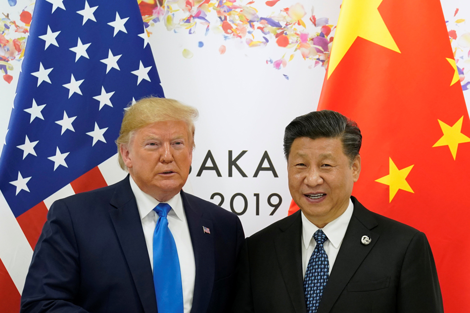 US President Donald Trump and China`s President Xi Jinping poses for a photo ahead of their bilateral meeting during the G20 leaders summit in Osaka, Japan, June 29, 2019. (Reuters)