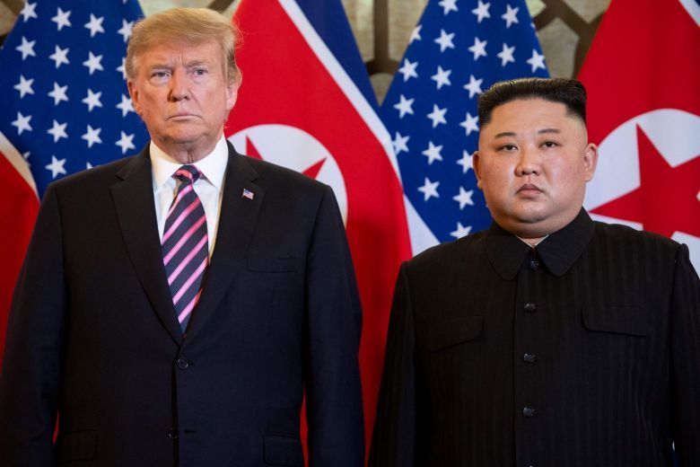 US President Donald Trump and North Korea's leader Kim Jong-un pose before a meeting at the Sofitel Legend Metropole hotel in Hanoi on Feb 27. (AFP)