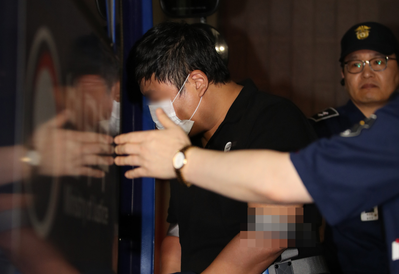 The son of Justice Minister Cho Kuk's cousin heads to a detention center, Monday. (Yonhap)