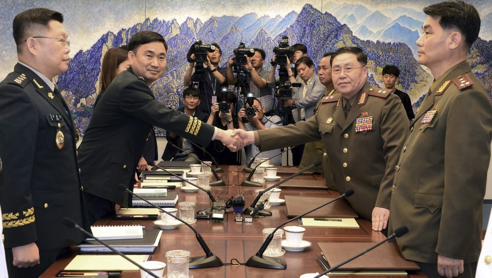 North Korean Lt. Gen. An Ik San (second right) shakes hands with his South Korean counterpart Maj. Gen. Kim Do-gyun during a meeting inside the Peace House at the border village of Panmunjom, South Korea, on July 31, 2018. (AP-Yonhap)