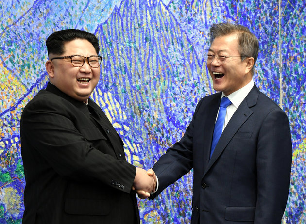 South Korean President Moon Jae-in(right) shakes hands with North Korea`s leader Kim Jong-un during their first summit at the truce village of Panmunjom in April, 2018. (Yonhap)