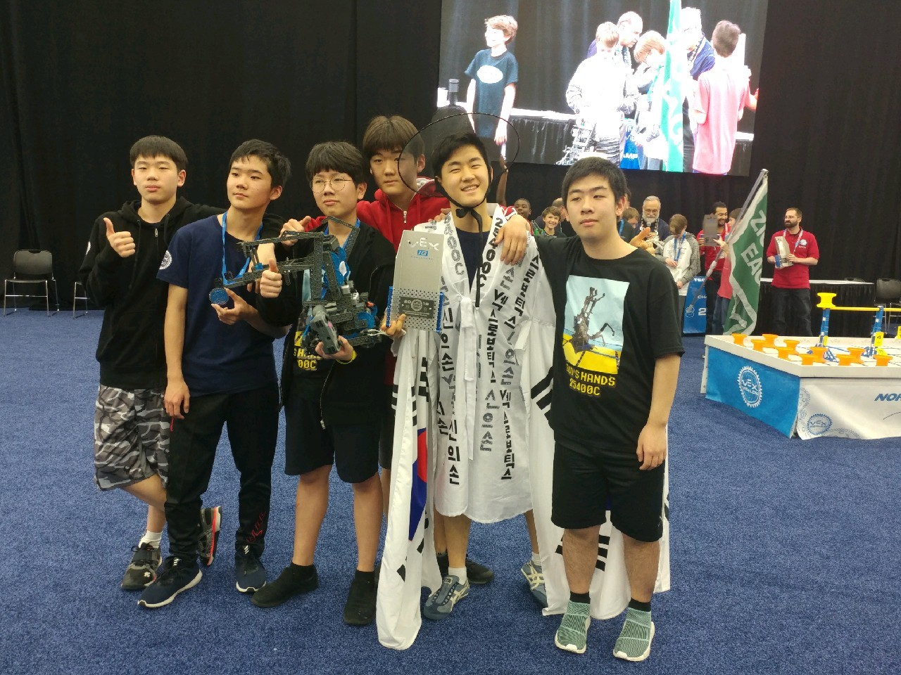 Dwight School Seoul robotics team members pose for pictures at the Vex Robotics World Championship in Kentucky, on May 1. (Dwight School Seoul)