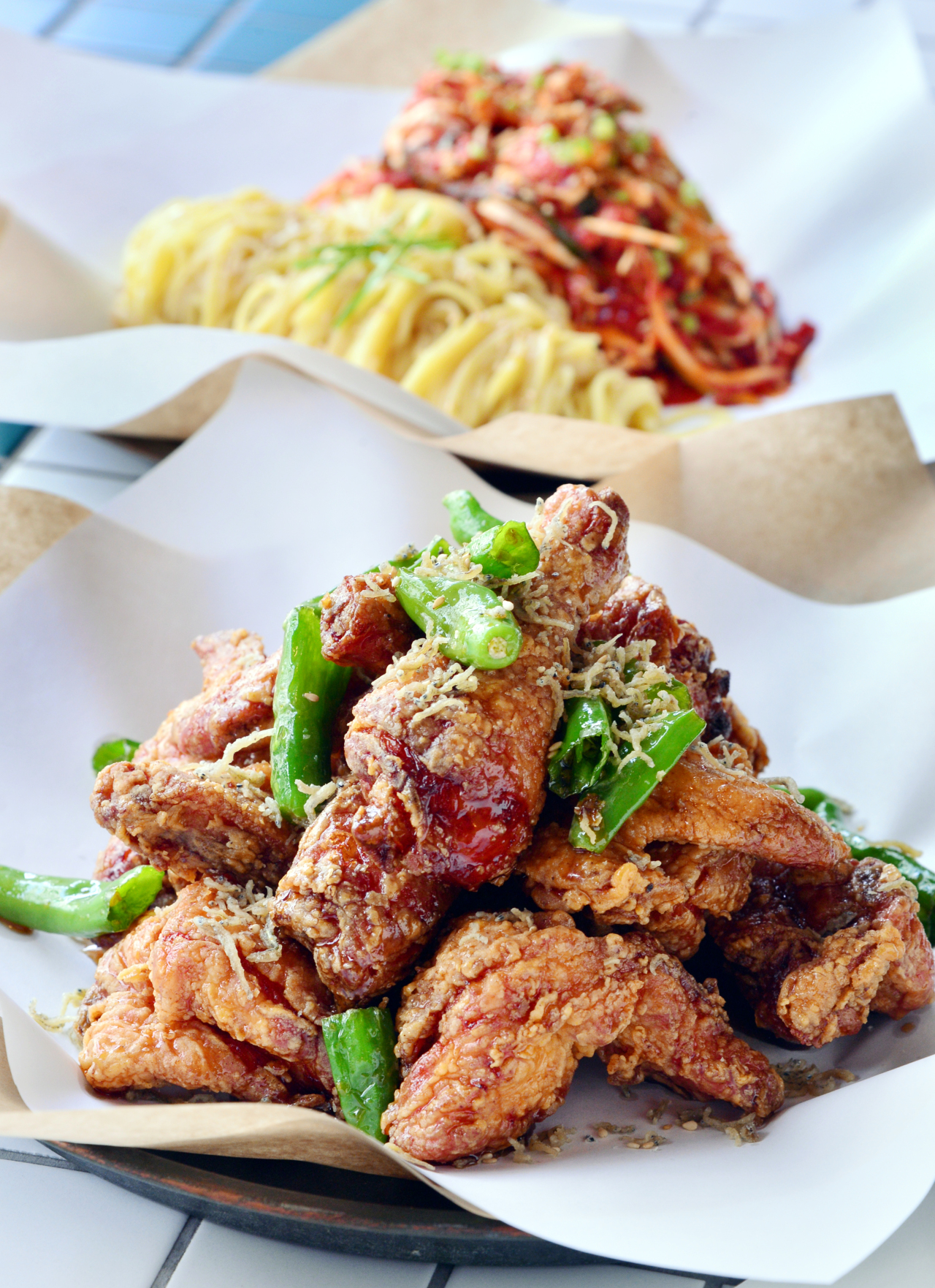 1) Hyodo's chewy spicy noodles with dried pollack (back) acts as the perfect foil to crisp, piping hot chicken, including Hyodo's popular soy sauce-based chicken (front). (Photo credit: Park Hyun-koo/The Korea Herald)