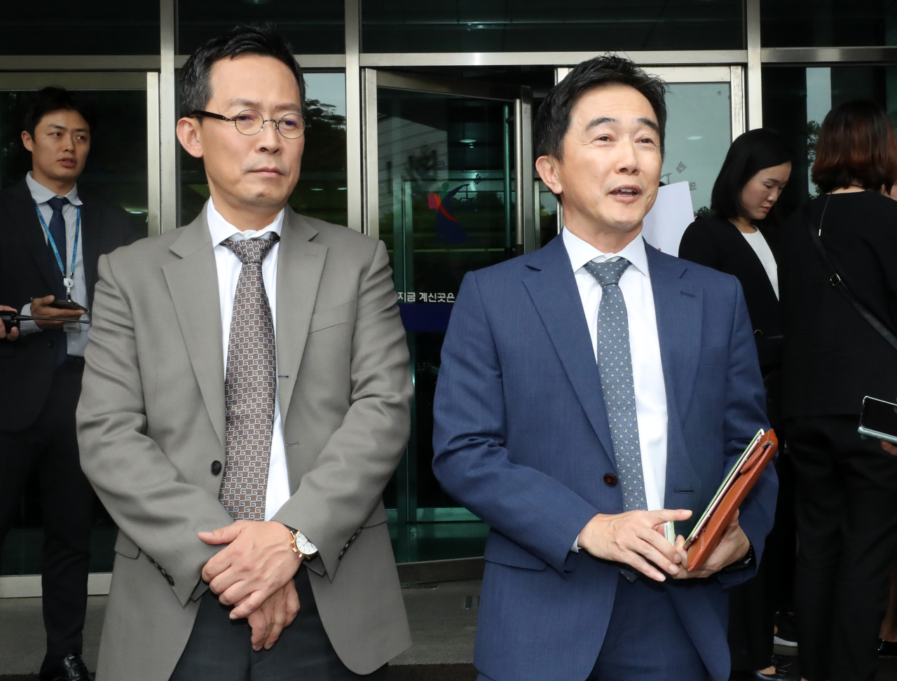 Steve Yoo`s lawyers speaks to the media on Friday in Seoul. (Yonhap)