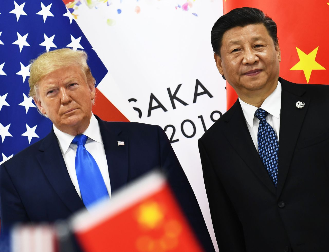 Chinese President Xi Jinping (right) and US President Donald Trump attend a bilateral meeting on the sidelines of the G-20 Summit in Osaka, Japan, on June 29. (AFP-Yonhap)