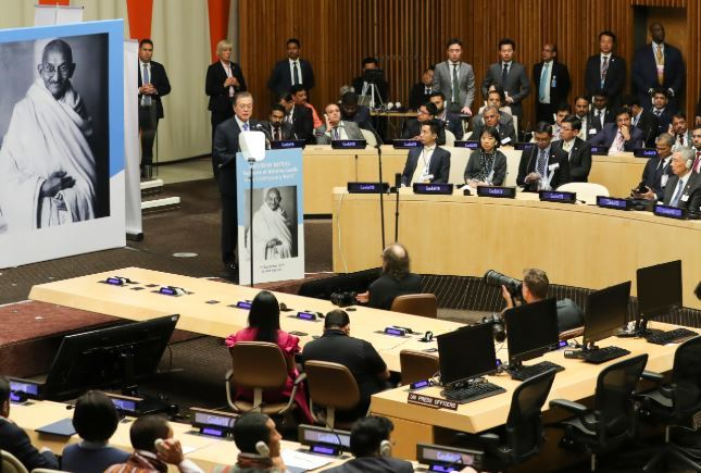 President Moon Jae-in speaks during a ceremony at the United Nations in New York on Tuesday to celebrate the 150th anniversary of the birth of Mahatma Gandhi, the leader of India's nonviolent independence movement against British rule. (Yonhap)
