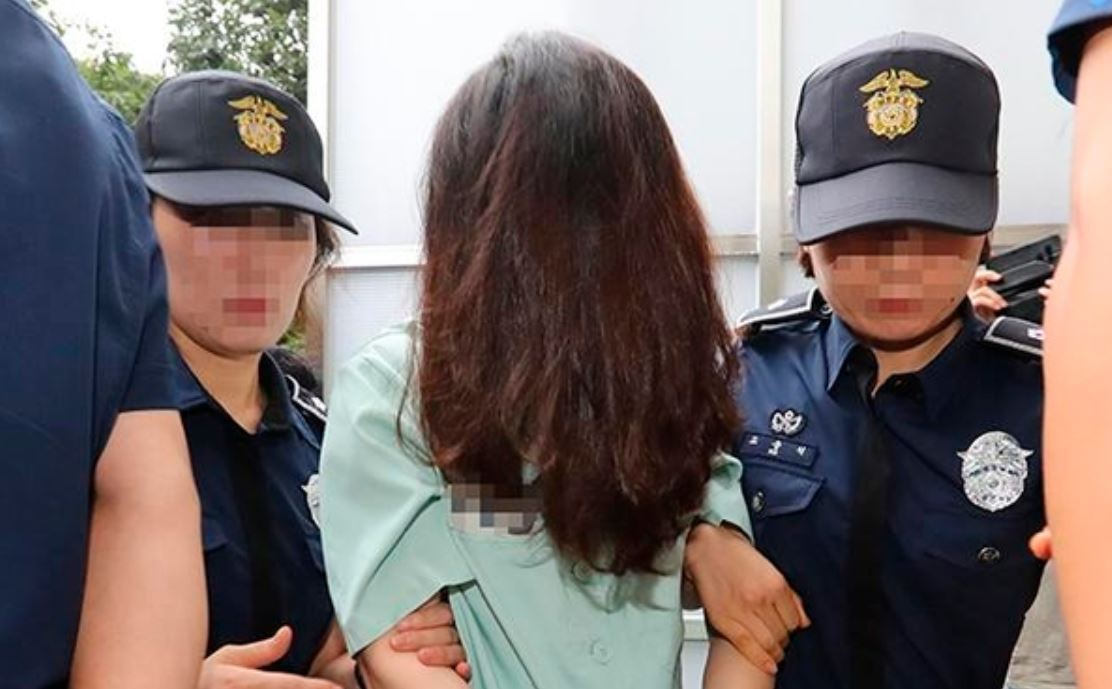 Police escort Koh Yu-jeong to Jeju court on Sept. 2. (Yonhap)