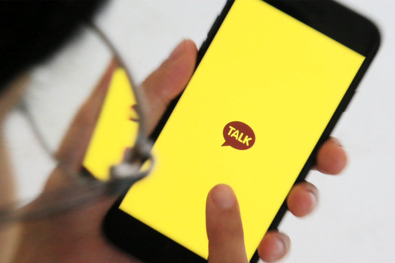 A smartphone user uses the KakaoTalk chatting app. Kakao