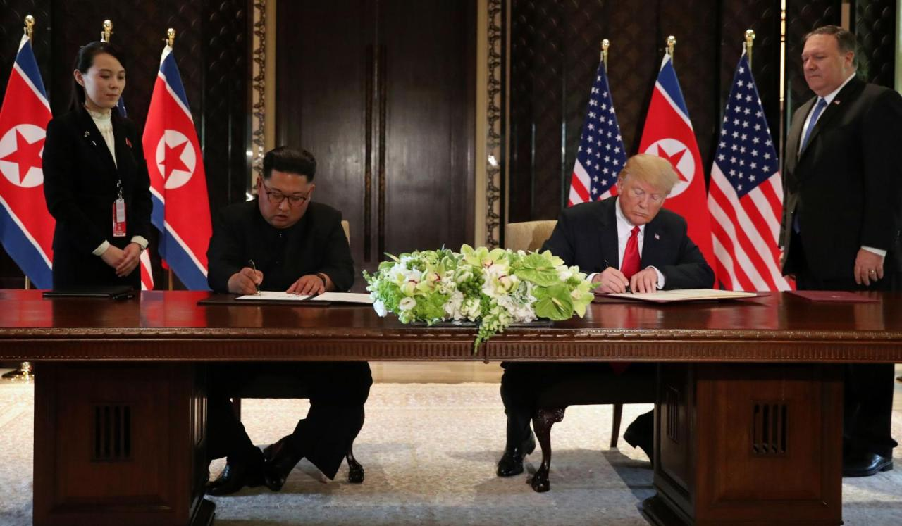 US President Donald Trump and North Korea's leader Kim Jong-un sign documents at a signing ceremony during the US-North Korea summit at the Capella Hotel on Sentosa island in Singapore on June 12, 2018. (AFP)