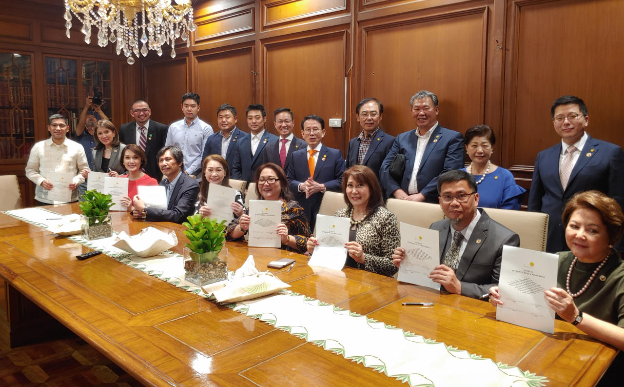 Members of the House of Representatives of the Philippines pose with Sunfull Foundation representatives at a signing event on Wednesday to mark the launch of the Sunfull Internet Peace Movement. (Sunfull Foundation)