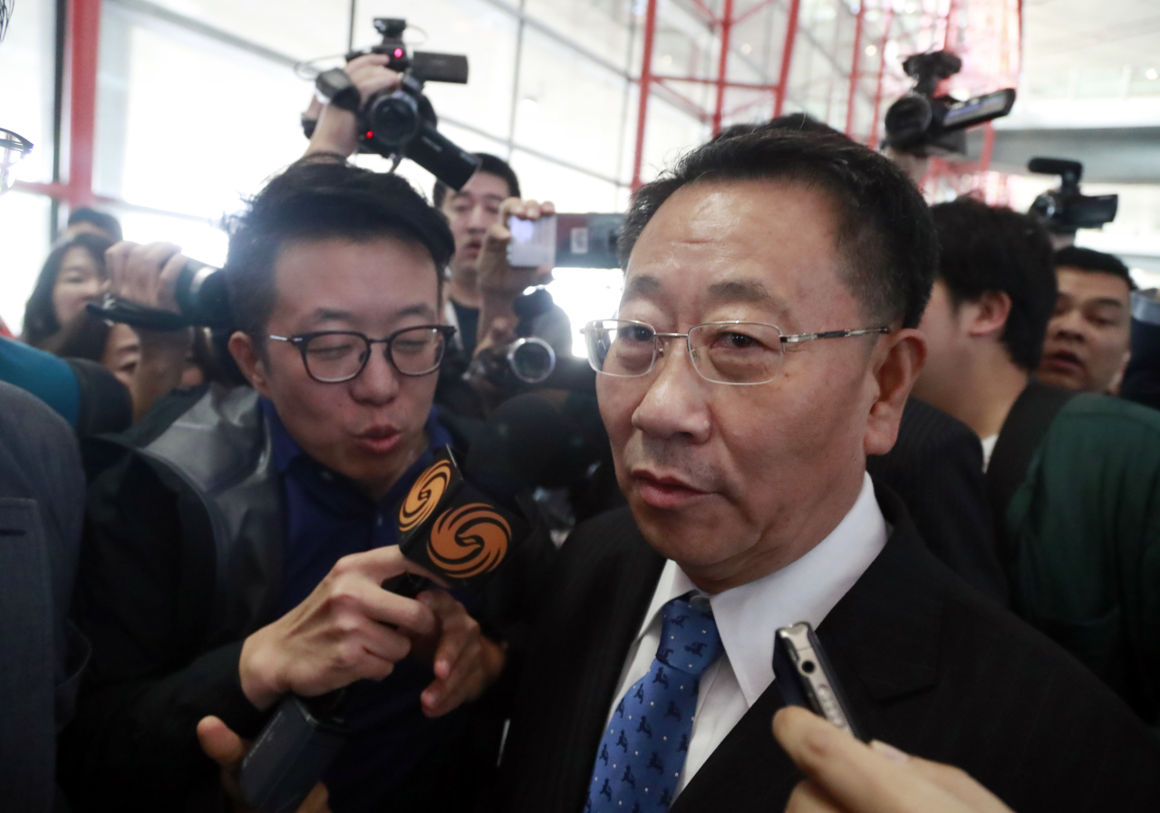 North Korea's top nuclear envoy Kim Myong-gil speaks to reporters upon his arrival at Beijing Capital International Airport en route to Pyongyang. (Yonhap)