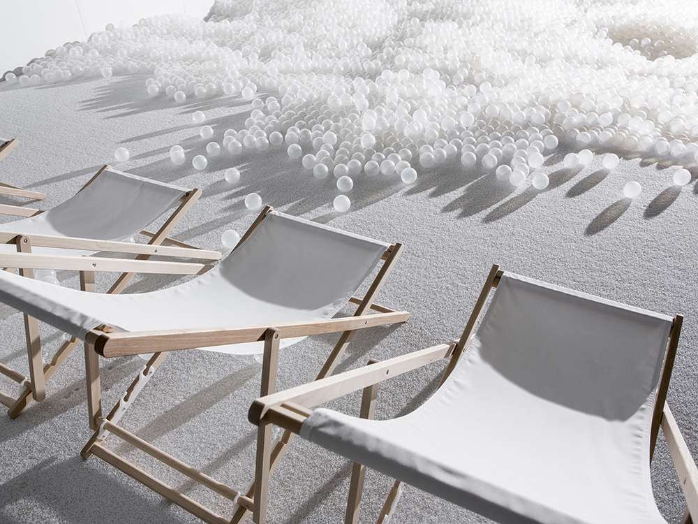 "Benches and translucent balls used for ""The Beach"" are on display at the National Building Museum in Washington in 2015. (Snarkitecture)"
