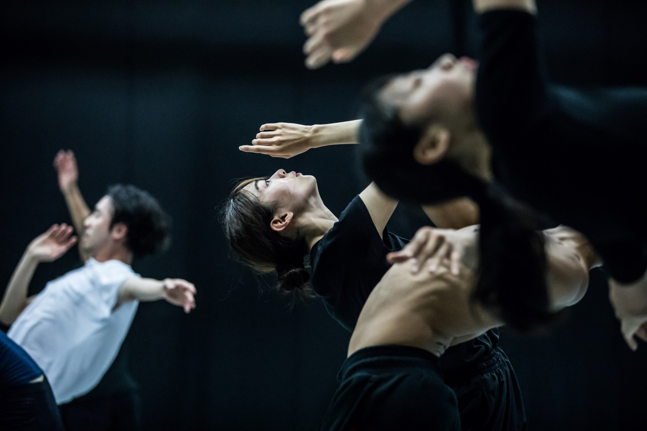 "The Korea National Contemporary Dance Company's dancers perform during a rehearsal for ""Traces of Black Sand."" (KNCDC)"