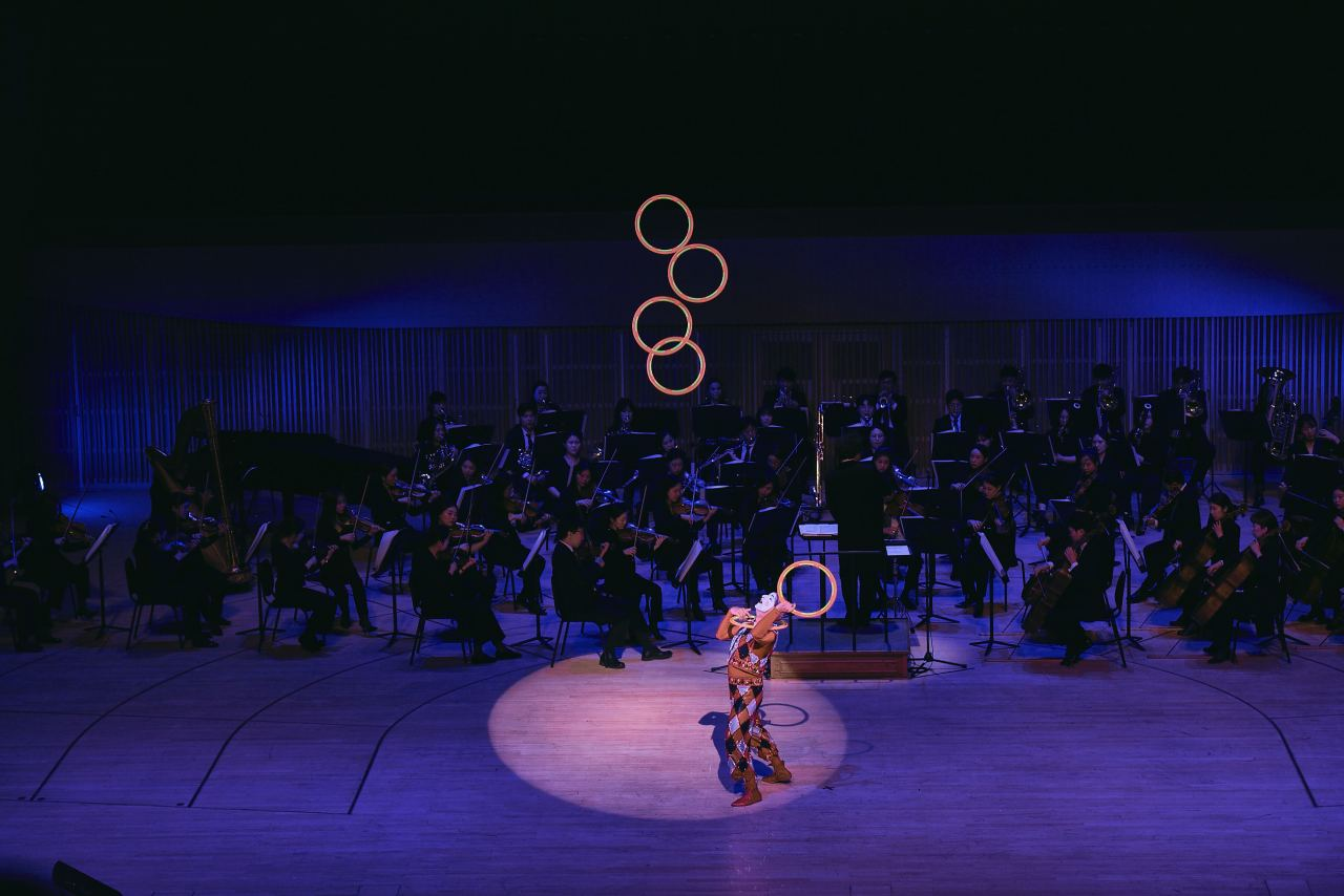 "A court jester juggles electric hoops to ""Dance Bohome"" from Bizet's Carmen Suite No. 2. (The Lotte Foundation for Arts)"