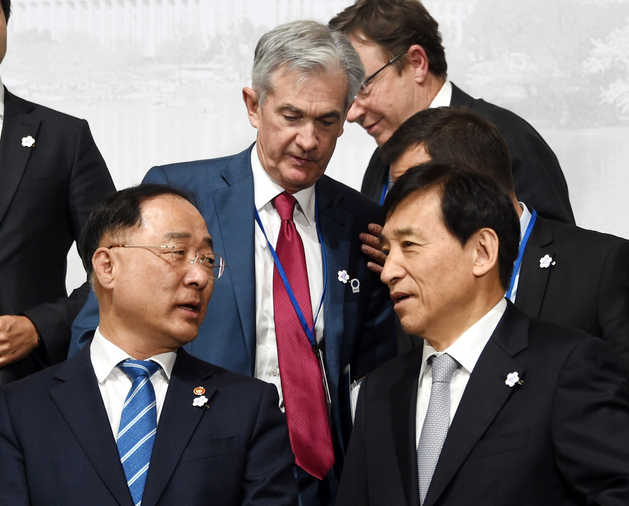 Deputy Prime Minister and Finance Minister Hong Nam-ki (left) and Bank of Korea Gov. Lee Ju-yeol attend the group photo session at the Group of 20 summit for finance ministers and central bank governors on Friday. (Ministry of Economy and Finance)