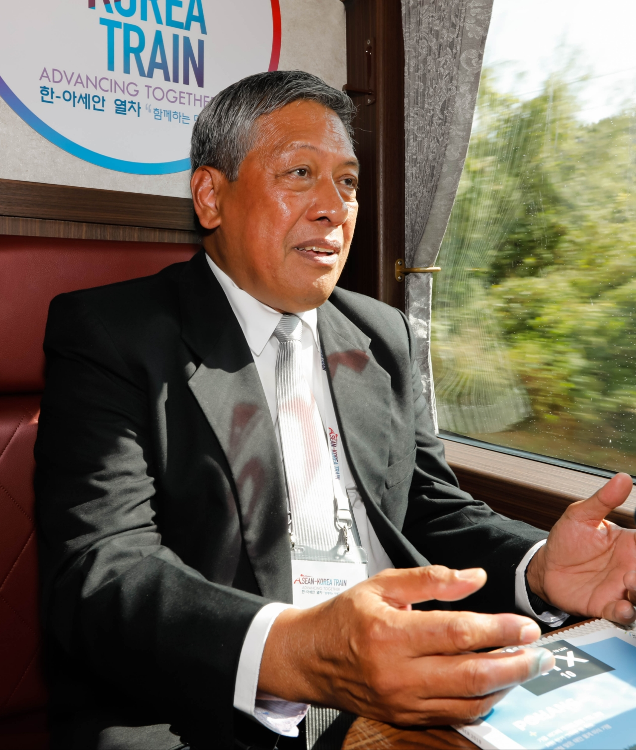 "Philippine Board of Investments Gov. Napoleon Concepcion speaks to The Korea Herald during an interview on the train to Gyeongju on the first day of the three-day voyage ""ASEAN-Korea Train: Advancing Together,"" Oct. 16. (ASEAN-Korea Center)"