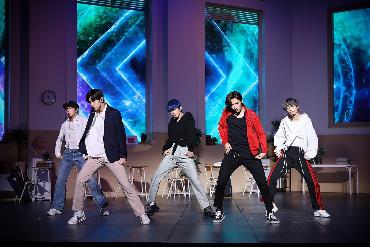 "TXT performs ""Run Away"" during a media showcase in Seoul on Monday. (Big Hit Entertainment)"
