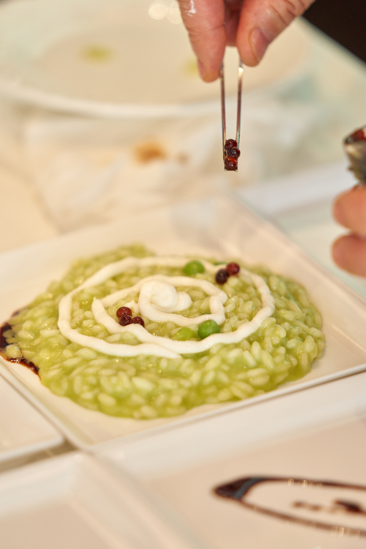 Carcangiu puts the finishing touches on risotto, made with ingredients sourced from Emilia-Romagna, northern Italy. (ITCCK)
