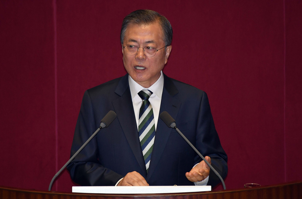 President Moon Jae-in addresses the parliament on Tuesday. (Yonhap)