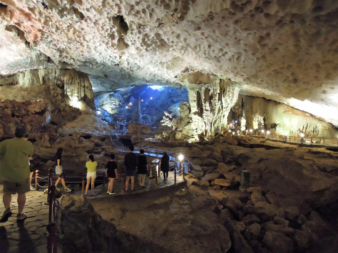 Visitors look around Sung Sot Cave in Halong Bay, Vietnam. (Paul Kerry/The Korea Herald)