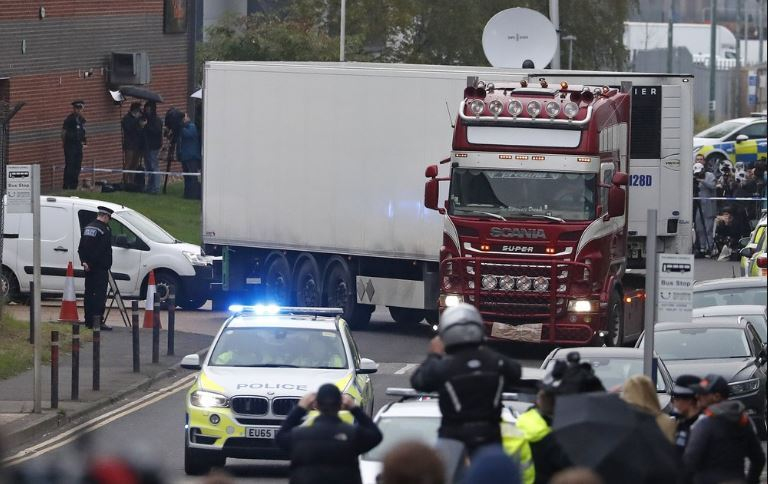 Police escort the truck, that was found to contain a large number of dead bodies, as they move it from an industrial estate in Thurrock, south England, Wednesday Oct. 23, 2019. Police in southeastern England said that 39 people were found dead Wednesday inside a truck container believed to have come from Bulgaria. (AP)