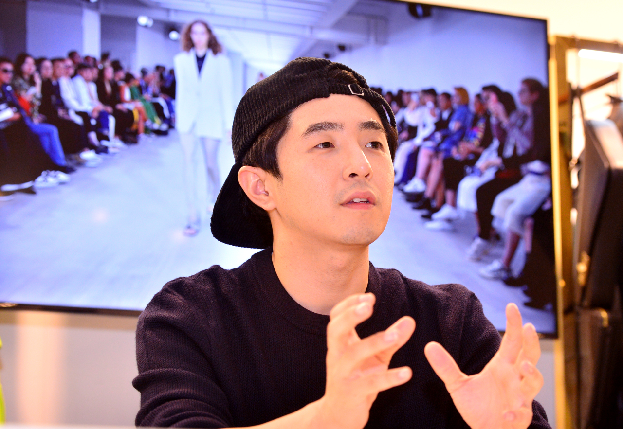 Designer Yoon Choon-ho, creative director of YCH, speaks during an interview with The Korea Herald during the spring-summer 2020 Seoul Fashion Week held at the Dongdaemun Design Plaza, central Seoul. (Park Hyun-koo / The Korea Herald)