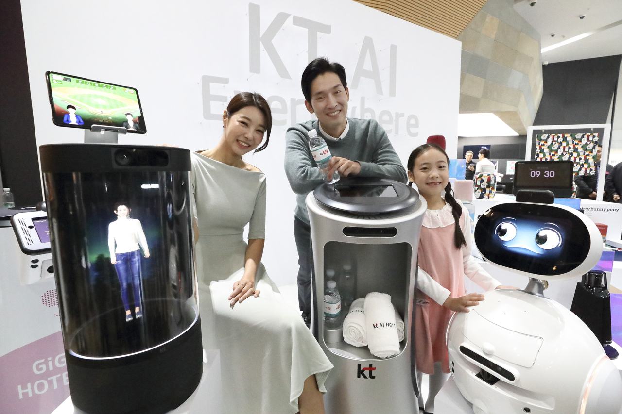 KT officials showcase its Giga Genie AI-powered devices during a press event in Seoul. KT