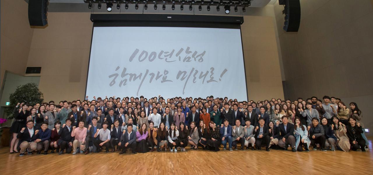 Samsung Electronics co-CEOs Kim Ki-nam, Koh Dong-jin and Kim Hyun-suk attend the 50th anniversary ceremony of the company in Suwon, Gyeonggi Province, Friday. (Samsung Electronics)
