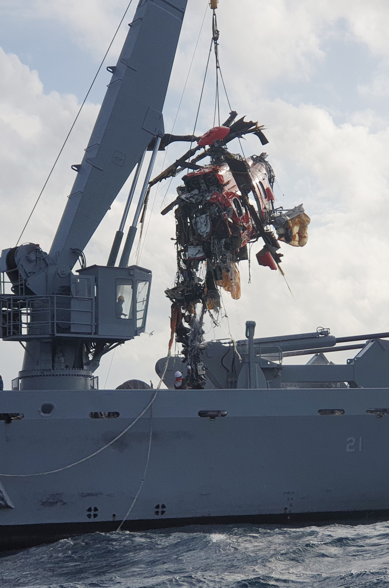 A salvaged chopper is being transported on Nov. 3 in the East Sea. (Yonhap)