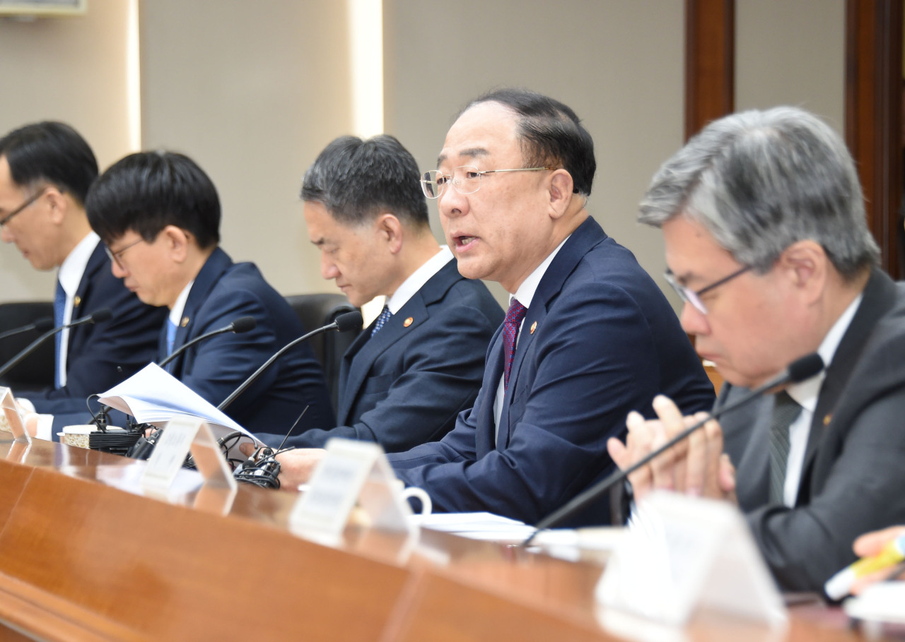 Deputy Prime Minister and Finance Minister Hong Nam-ki chairs a ministerial meeting on economic revitalization on Wednesday. (Ministry of Economy and Finance)