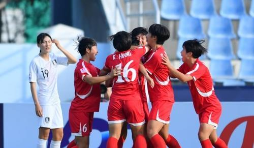 This photo provided by the Asian Football Confederation on Nov. 6, 2019, shows North Korean players (in red) celebrating their goal against South Korea in the semifinals of the AFC U-19 Women's Championship at Chonburi Stadium in Chonburi, Thailand. (Yonhap)