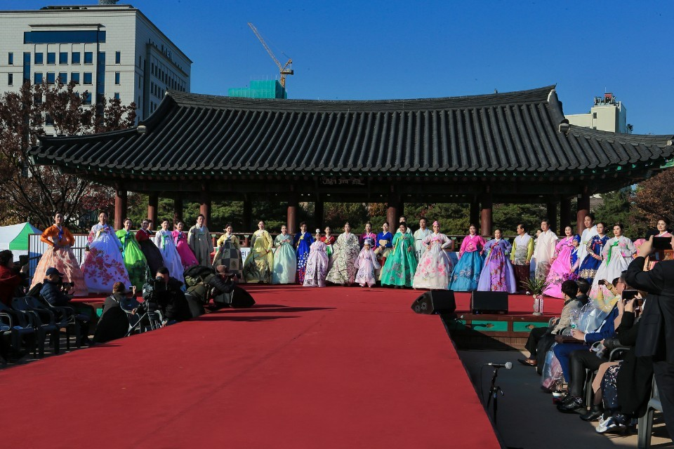 Models walk the runway finale at a hanbok show, organized by Korea Senior Star Association, at Namsangol Hanok Village in Seoul, Saturday. (Korea Senior Star Association)