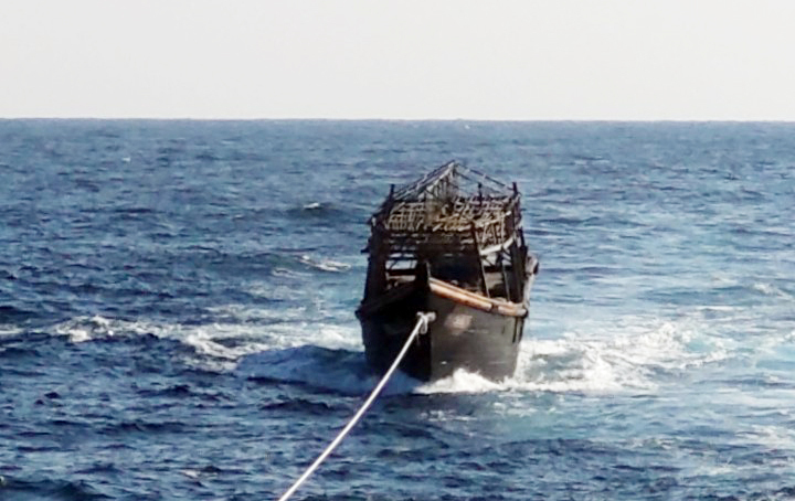The South Korean Navy tows the North Korean wooden boat to the North in the East Sea, Nov. 8. (Yonhap)