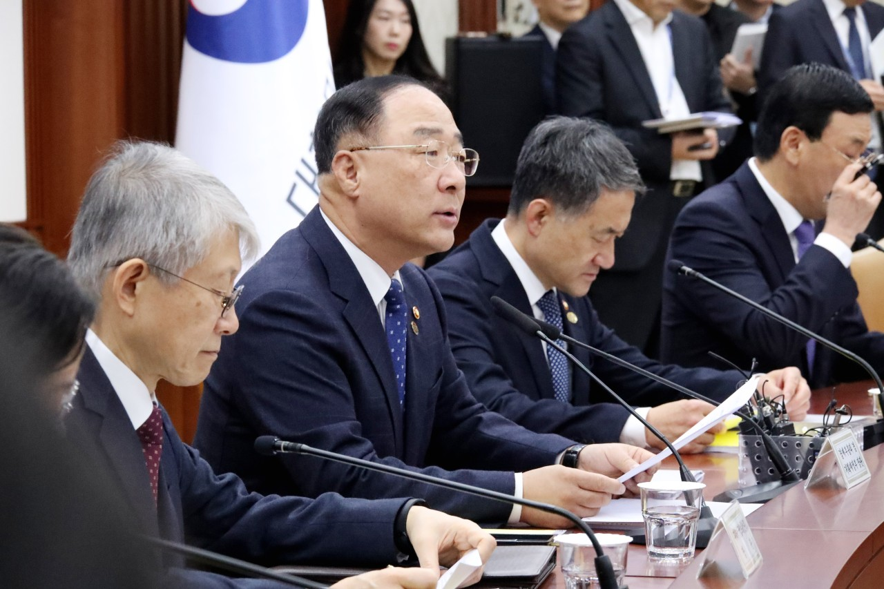 Deputy Prime Minister and Finance Minister Hong Nam-ki (second from left) speaks in a policy meeting for economic revitalization at the Seoul Government Complex on Wednesday. (Yonhap)