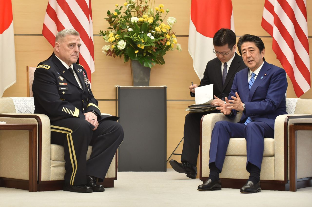 Japan`s Prime Minister Shinzo Abe meets with US Chairman of the Joint Chiefs of Staff Gen. Mark Milley (L) at the Abe`s office in Tokyo on Wednesday. Yonhap