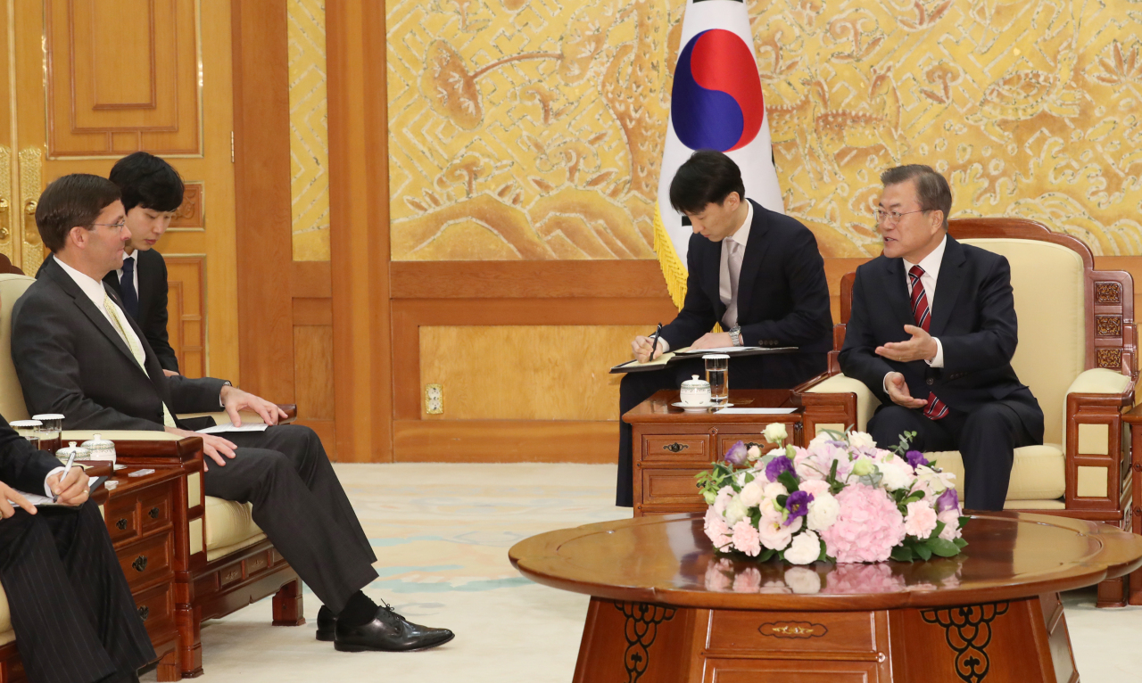 President Moon Jae-in meets with US Defense Secretary Mark Esper at the presidential office on Friday. Yonhap