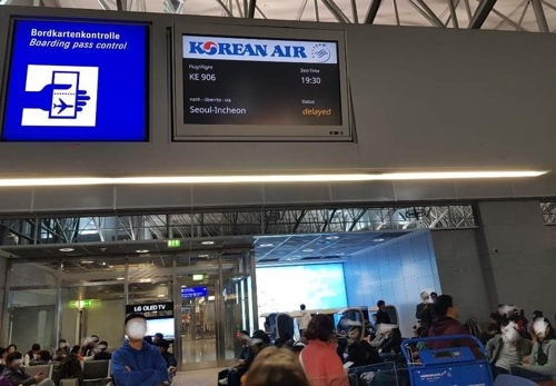 In a photo provided by a passenger, Korean Air flight KE 906 is marked as delayed. (Yonhap)